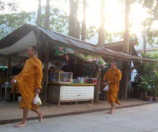 Buddhist monks on alms round in Thailand