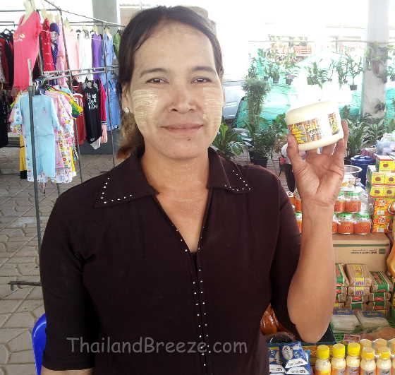A Burmese vendor selling thanaka cosmetics in Thailand.