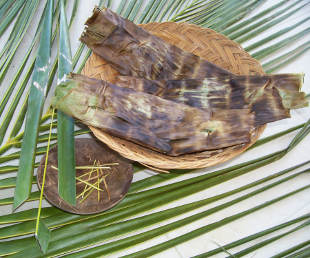 Coconut leaves made into a basket and pins