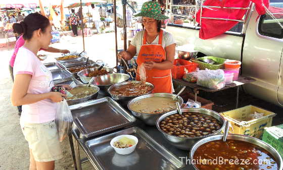 Cooked food at a weekly local market in Prachuap, Thailand.