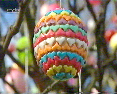 An Easter egg decorated with sugar hearts.