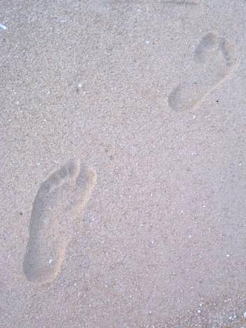 Give yourself a natural foot massage while strolling on the beach