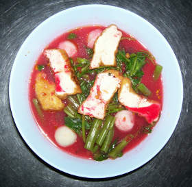 Thai noodle soup with fermented red soy beans