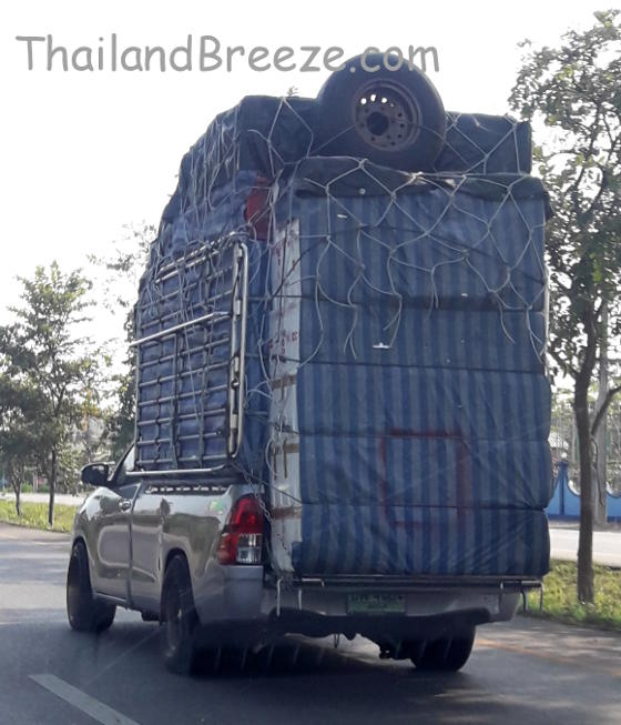 Overloaded pickup trucks is a common sight in Thailand