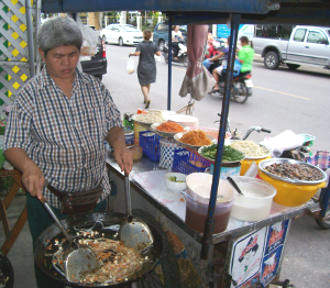 Phad Thai noodles prepared by a street vendor in Thailand