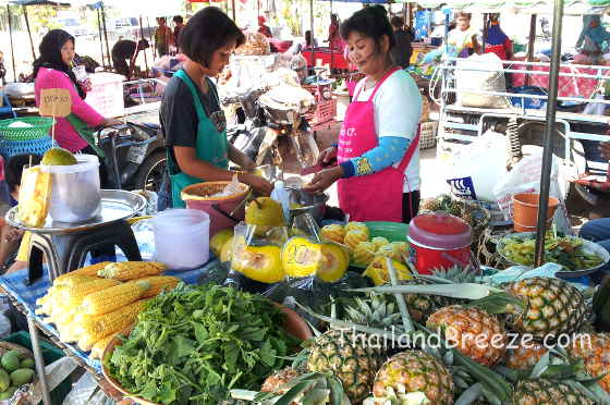 Raw vegetables and pineapples at a weekly local market in Thailand.