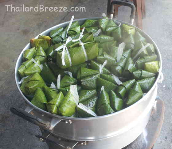 Steaming kao tom mud wrapped in banana leaf in Thailand.