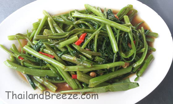 Stir-fried water spinach is called pad pak boong in Thai.