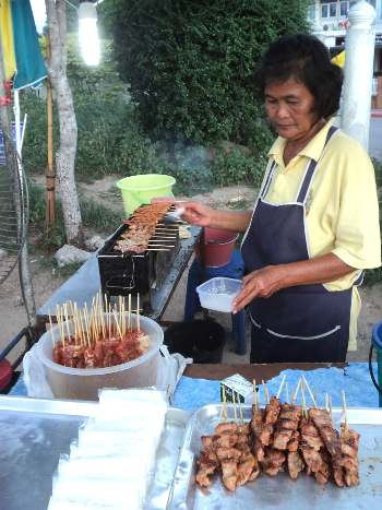 Sticky rice and grilled pork is common at night markets in Thailand