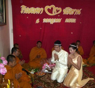 Buddhist monks chanting at a wedding ceremony in Thailand