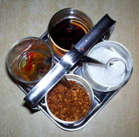 Thai noodle condiments at a restaurant in Thailand