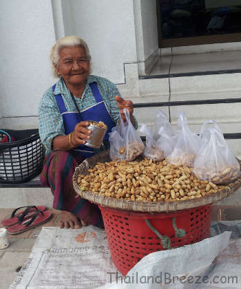 A street vendor who sells peanuts in Thailand.
