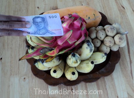 Many superstitious Thai vendors pat their goods with money for good business.
